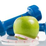 green apple, free weights and tape measure for vein health resolution